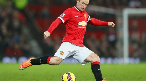 Hoping to make it: Manchester United striker Wayne Rooney is expected to be fit after injuring his knee on Saturday