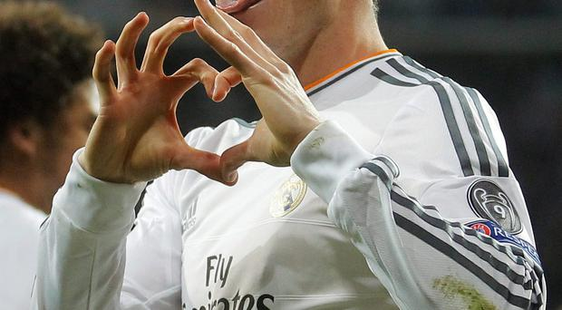 Going nowhere: Gareth Bale is happy with his life and football in Madrid