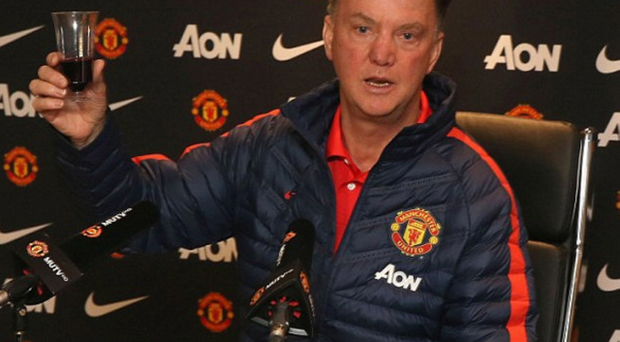Manchester United boss Louis Van Gall raises a glass in festive celebration with the assembled media