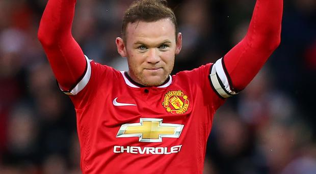 Rested: Wayne Rooney says United will reap the benefits from the break yesterday