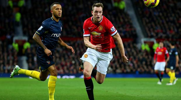 Shock loss: Phil Jones in action with Ryan Bertrand in the 1-0 defeat to the Saints