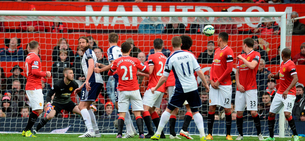 Touch of fortune: Chris Brunt's deflected free-kick finds the net to earn West Brom victory at Old Trafford