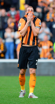 Going down: Hull City's Michael Dawson endures heartbreak