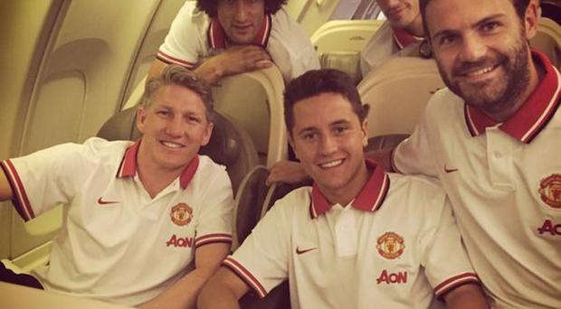 Jetting off: Man United new boys Bastian Schweinsteiger and Morgan Schneiderlin joined Marouane Fellaini, Ander Herrera and Juan Mata as the Red Devils headed for the USA