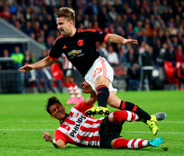 Bad break: Luke Shaw suffered a double leg break after this challenge from PSV Eindhoven's Hector Moreno in the Champions League