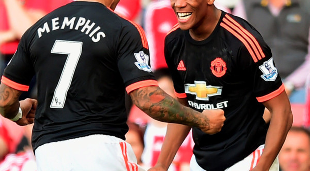 Wonder boy: Anthony Martial celebrates with Memphis Depay after netting his second goal yesterday