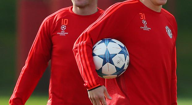United we stand: Red Devils' skipper Wayne Rooney and Bastian Schweinsteiger in training for tonight's game