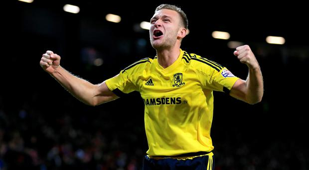 Middlesbrough's Ben Gibson celebrates winning the penalty shootout following the Capital One Cup, Fourth Round match at Old Trafford, Manchester. PRESS ASSOCIATION Photo. Picture date: Wednesday October 28, 2015. See PA story SOCCER Man Utd. Photo credit should read: Nigel French/PA Wire. RESTRICTIONS: EDITORIAL USE ONLY No use with unauthorised audio, video, data, fixture lists, club/league logos or