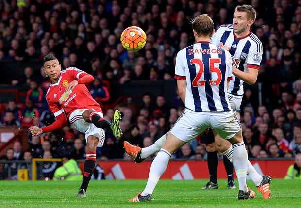 Super strike: Jesse Lingaard curls home Man United's opener against West Brom on Saturday