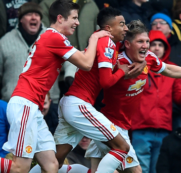 Late show: Paddy McNair and Jesse Lingard celebrate with Bastian Schweinsteiger as United claimed the victory