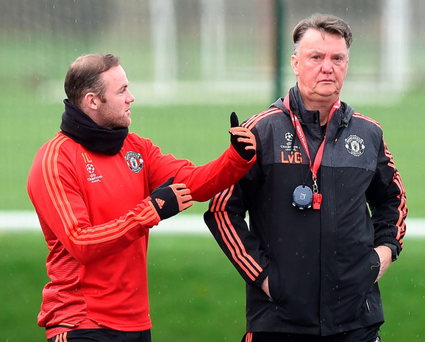 In discussion: Wayne Rooney has a chat with manager Louis van Gaal as United prepare for the Champions League clash against PSV Eindhoven
