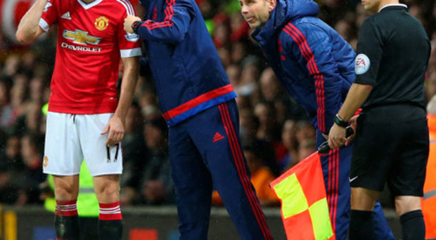 Showing the way: Manchester United assistant manager Ryan Giggs issues instructions to Daley Blind during the weekend's defeat to Norwich