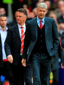 Support: Arsenal manager Arsene Wenger says rumours about Louis van Gaal's position are disrespectful