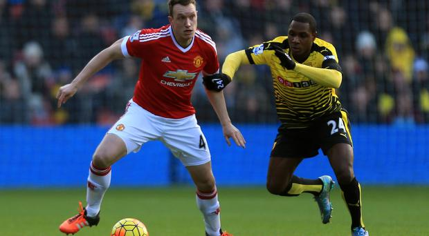 WATFORD, ENGLAND - NOVEMBER 21: Phil Jones of Manchester United and Odion Ighalo of Watford compete for the ball during the Barclays Premier League match between Watford and Manchester United at Vicarage Road on November 21, 2015 in Watford, England. (Photo by Stephen Pond/Getty Images)