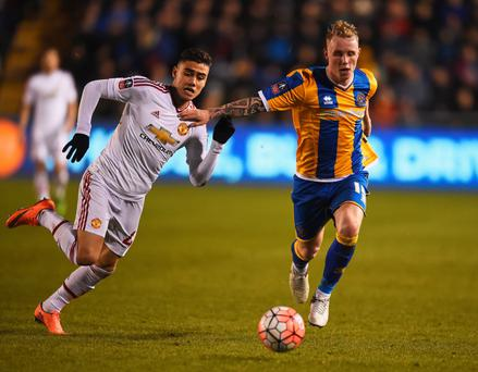 Hand off: Shrewsbury's Jack Grimmer attempts to stop Manchester United's Andreas Pereira getting to the ball