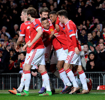 Euro star: Marcus Rashford is mobbed by his Manchester United team mates after scoring his second goal of the game