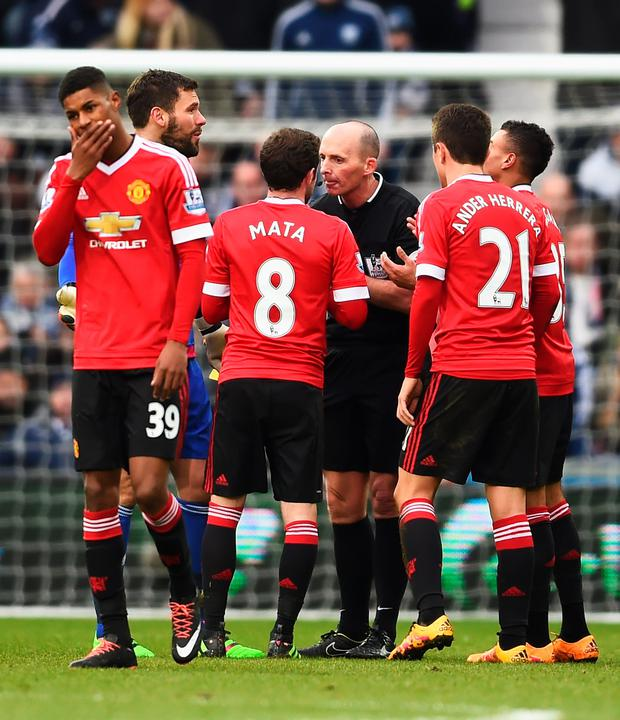 Red mist: Mike Dean sends off Man United's Juan Mata