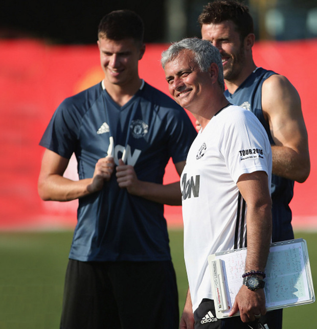Bright future: Jose Mourinho, Paddy McNair and Michael Carrick at training in Shanghai
