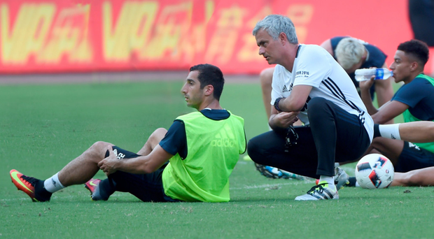 Down to work: Jose Mourinho takes training in Shanghai yesterday