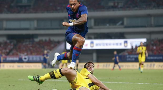 Out to impress: Memphis Depay in action against Borussia Dortmund