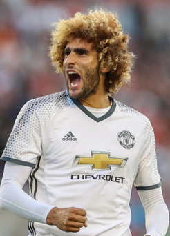 Staying: Marouane Fellaini has been given a lifeline by Jose Mourinho