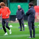 Watchful eye: Jose Mourinho presides over United training