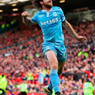 Joy: Joe Allen salutes his equaliser for Stoke