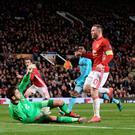 Touch of class: Wayne Rooney breaks the deadlock with a delicate chip over Feyenoord keeper Brad JonesTouch of class: Wayne Rooney breaks the deadlock with a delicate chip over Feyenoord keeper Brad Jone