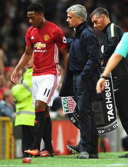 Sidelined: The United career of Anthony Martial (left) has stalled under Jose Mourinho (right)