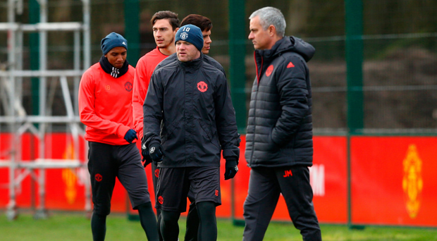 Strained relations: Jose Mourinho insists he is not trying to force Wayne Rooney out of Old Trafford