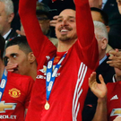 Prize guy: Zlatan Ibrahimovic lifts the EFL Cup at Wembley