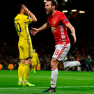 Shining light: Juan Mata celebrates his strike, which helped United to progress to the quarter-finals