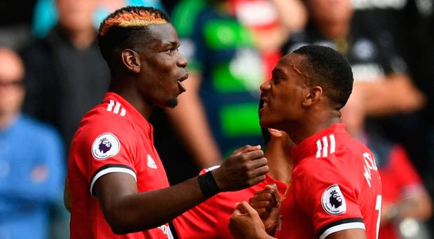 Helping hand: Paul Pogba has been hailed by Anthony Martial