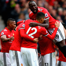 Top heavy: Romelu Lukaku joins in the celebrations after Marouane Fellaini nets United's third