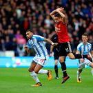 Out-worked: Ander Herrera gives chase to Huddersfield's Danny Williams