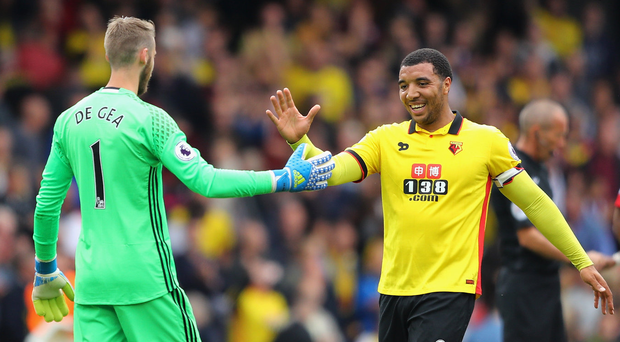 Smiling assassin: Troy Deeney greets United keeper David de Gea after Watford's win last season