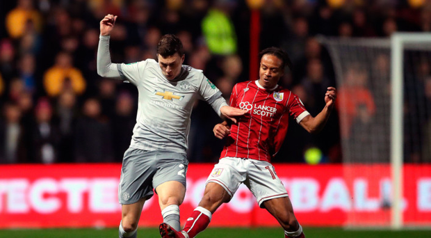 Tussle: United defender Victor Lindelof is tackled by Bobby Reid
