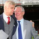 Special relationship: Sir Alex Ferguson presents Arsene Wenger with a memento on the pitch at Old Trafford last week