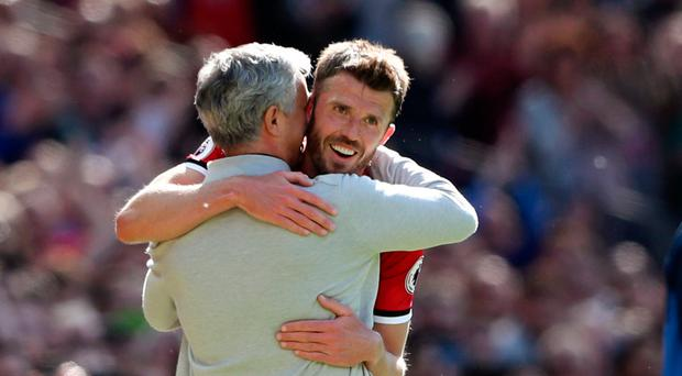 Ovation: Michael Carrick embraces Jose Mourhino