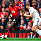 Right attitude: Paul Pogba races away from Ryan Bennett