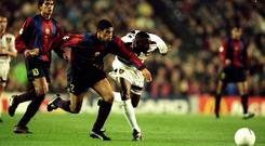 Foot race: Andy Cole battles with Barcelona's Michael Reiziger during Manchester United's 1998 Champions League tie
