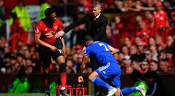 Middle man: Ole Gunnar Solskjaer gets between Anthony Martial and Lee Peltier at Old Trafford