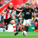 Keeping control: Juan Mata battles for possession with Southampton's Oriol Romeu during Saturday's draw
