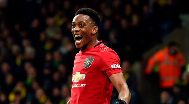 Grinning mentality: Anthony Martial is all smiles after netting United's third goal