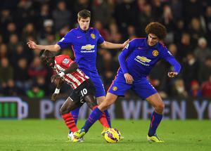 Tough night: Paddy McNair in action with Marouane Fellaini against Southampton