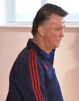 Goodbye and Merry Christmas: Manchester United manager Louis van Gaal walks out of yesterday's press conference, clearly rattled by the constant speculation regarding his future as Old Trafford boss