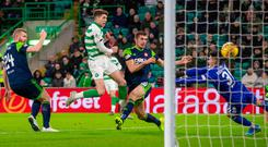 Head man: Celtic's Ryan Christie (centre) scores his side's first goal of the game against Hamilton