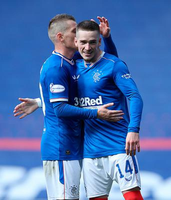 On target: Ryan Kent celebrates his goal with Northern Ireland international Steven Davis