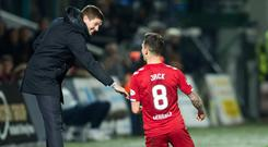 Streets ahead: Ryan Jack celebrates his goal against Ross County with Rangers manager Steven Gerrard last Wednesday