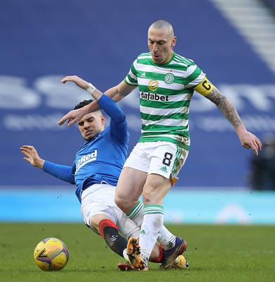 Still fighting: Celtic's Scott Brown isn't giving up on the title despite 21-point gap